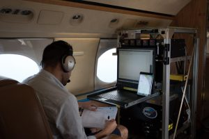 A NASA engineer operations the PRISM instrument aboard the G4