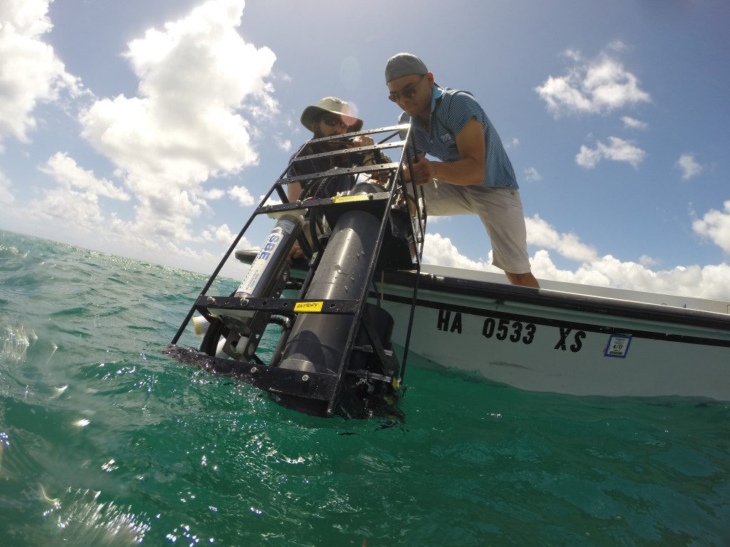 Brandon Russell drops the inherent optical properties cage into the water