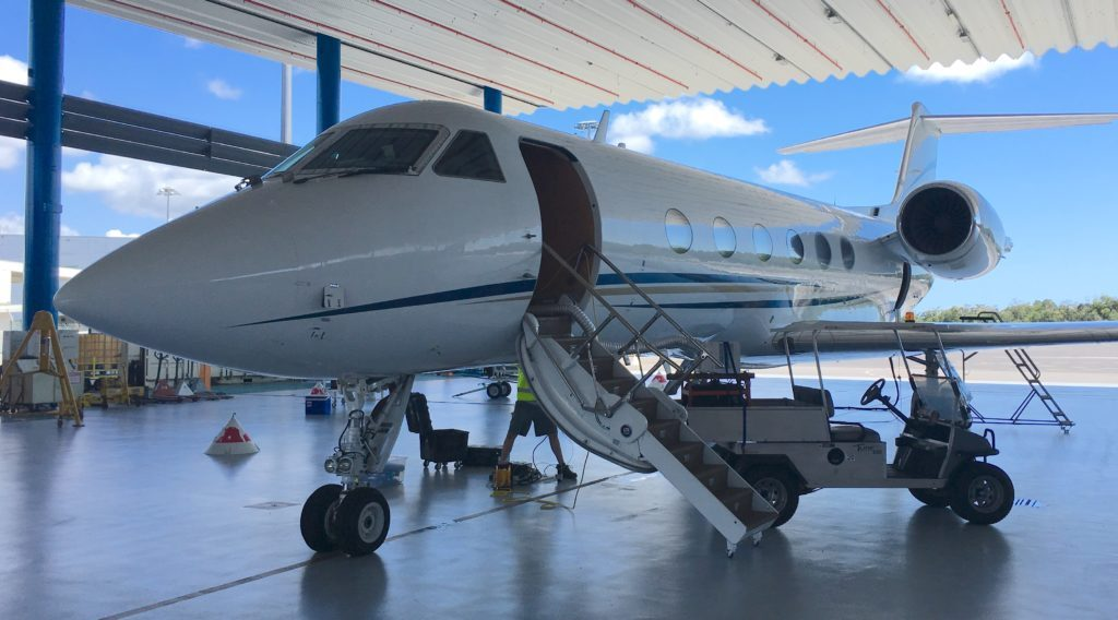 The Gulfstream IV plane carrying the Coral Reef Airborne Laboratory's (CORAL) Portable Remote Imaging Spectrometer (PRISM) instrument sits in Hawker Pacific's hangar at Cairns Airport. Credit: NASA/Alan Buis